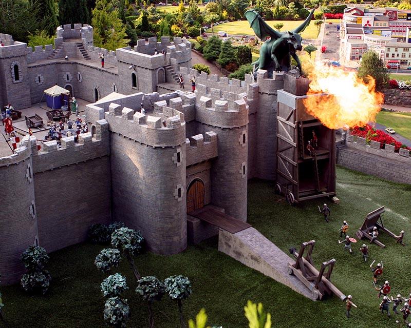 Fire breathing dragon on the castle